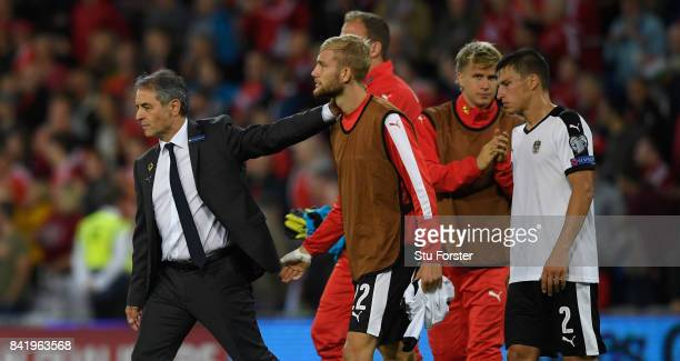 Austria manager Marcel Koller consoles his players after the FIFA 2018 World Cup Qualifier between Wales and Austria at Cardiff City Stadium on...