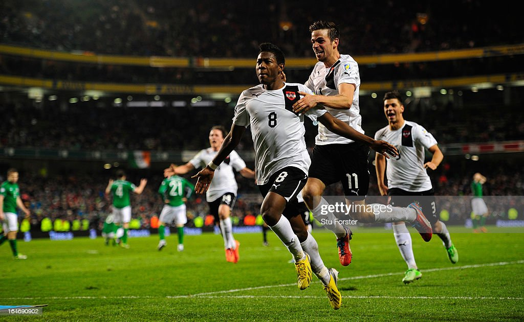 Austria player <a gi-track='captionPersonalityLinkClicked' href=/galleries/search?phrase=David+Alaba&family=editorial&specificpeople=5494608 ng-click='$event.stopPropagation()'>David Alaba</a> (8) celebrates his last minute goal to make the score 2-2 during the FIFA 2014 World Cup Group C Qualifiying match between Republic of Ireland and Austria at Aviva Stadium on March 26, 2013 in Dublin, Ireland.