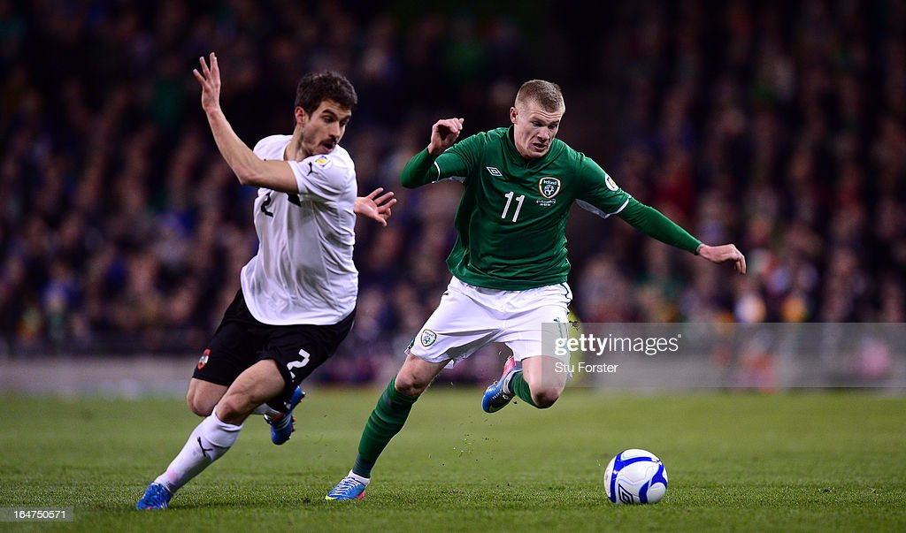 Austria player Gyorgy Garics (2) challenges Ireland winger James McClean (11) during the FIFA 2014 World Cup Group C Qualifiying match between Republic of Ireland and Austria at Aviva Stadium on March 26, 2013 in Dublin, Ireland.