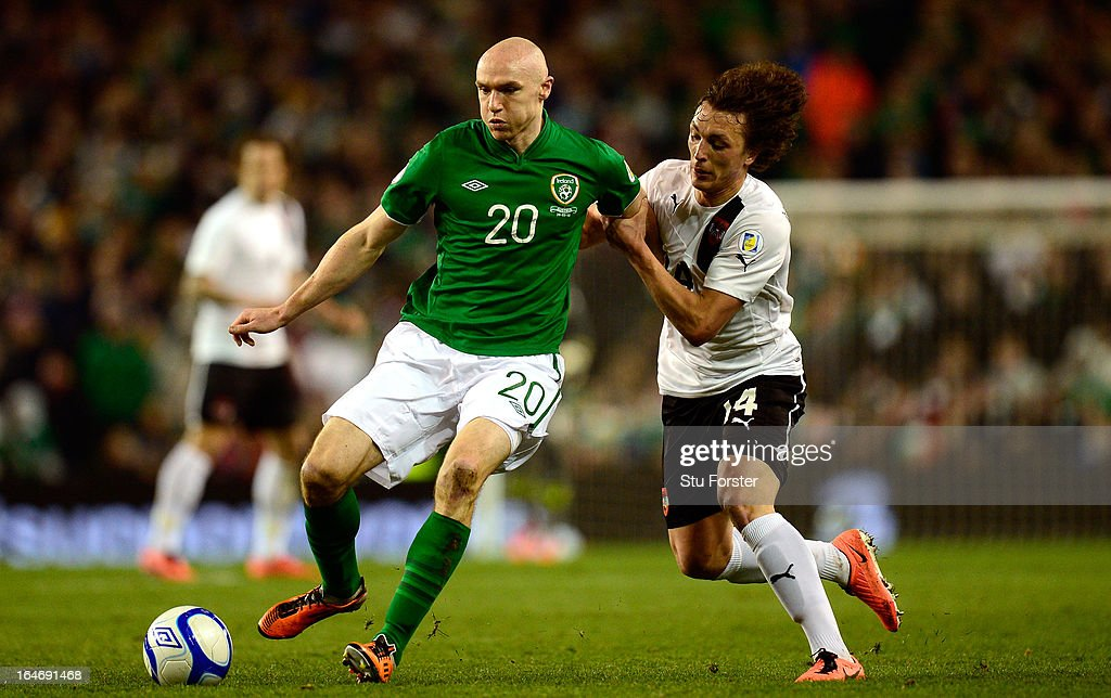 Austria player Julian Baumgartlinger (r) battles for the ball with Conor Sammon of Ireland during the FIFA 2014 World Cup Group C Qualifiying match between Republic of Ireland and Austria at Aviva Stadium on March 26, 2013 in Dublin, Ireland.