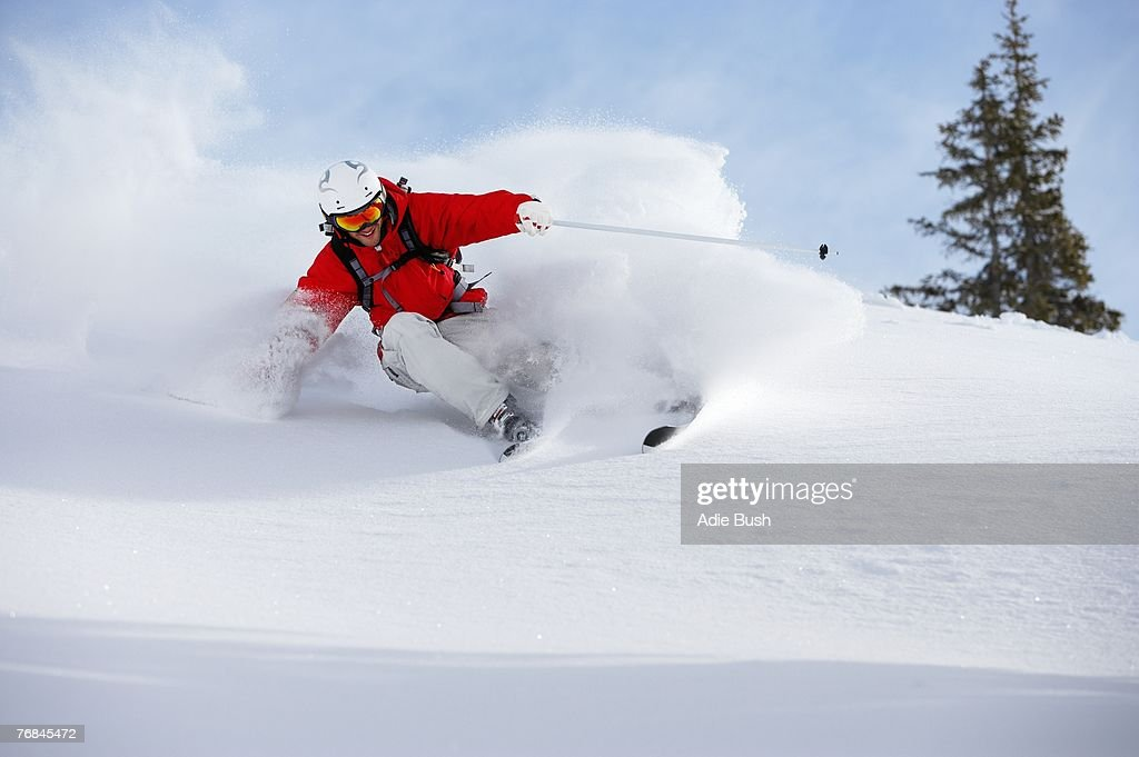Austria, Saalbach, male skier turning in snow on slope : Stock Photo