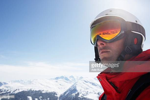 Austria, Saalbach, male skier wearing helmet and goggles, close-up