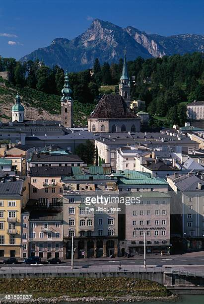 Austria Salzburg City view with Untersburg Mountain behind Church spire and towers and buildings with flat rooftops and roof and window balconies