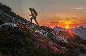 Austria, Salzburg Country, Man hiking through Niedere Tauern mountains at sunrise