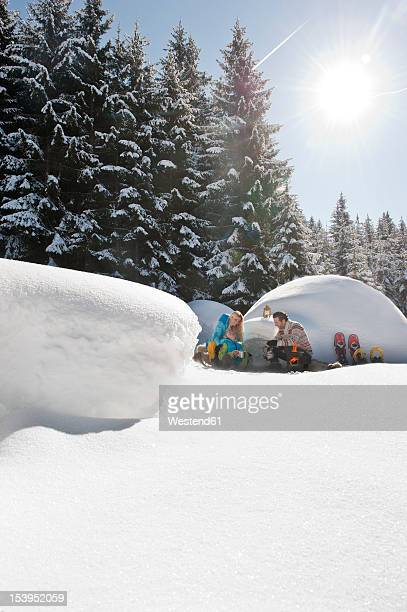 Austria, Salzburg County, Couple sitting near igloo