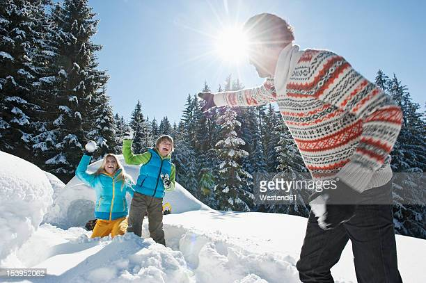 Austria, Salzburg County, Family playing near igloo