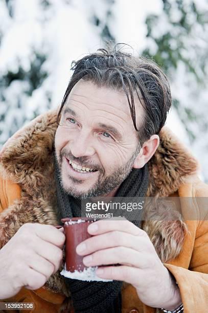Austria, Salzburg County, Mature man drinking tea, smiling