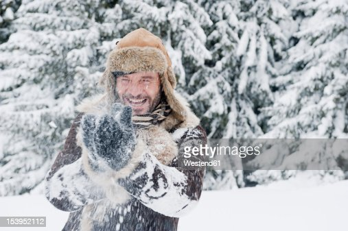 Austria, Salzburg County, Mature man having fun in snow, smiling