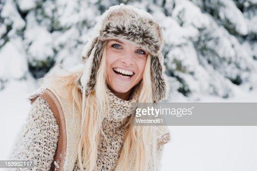 Austria, Salzburg County, Mid adult woman smiling, portrait