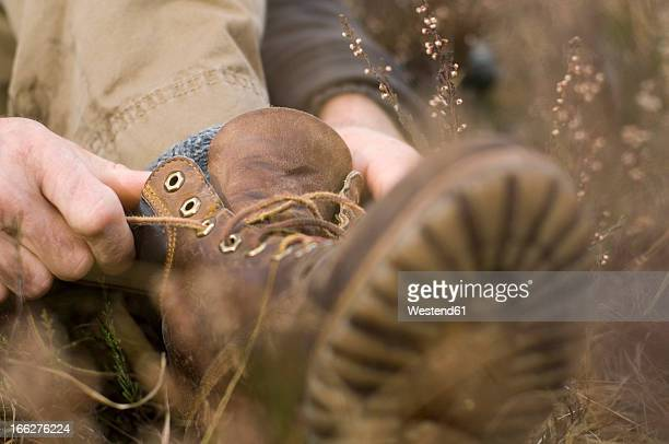 Austria, Salzburg County, Person putting on her shoes, close-up