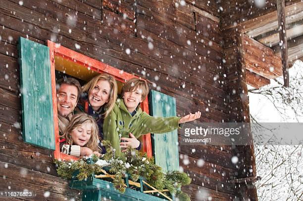 Austria, Salzburg, Httau, Family in a farmhouse, smiling