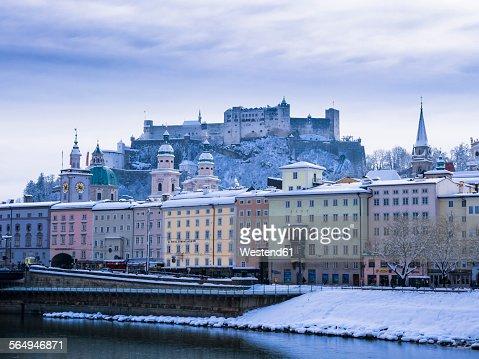 Austria, Salzburg, Old town, Salzach river, Hohensalzburg Fortress and churches in winter