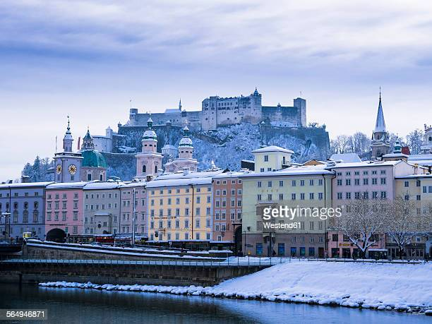 Austria, Salzburg, Old town, Salzach river, Hohensalzburg Fortress and churches in winter