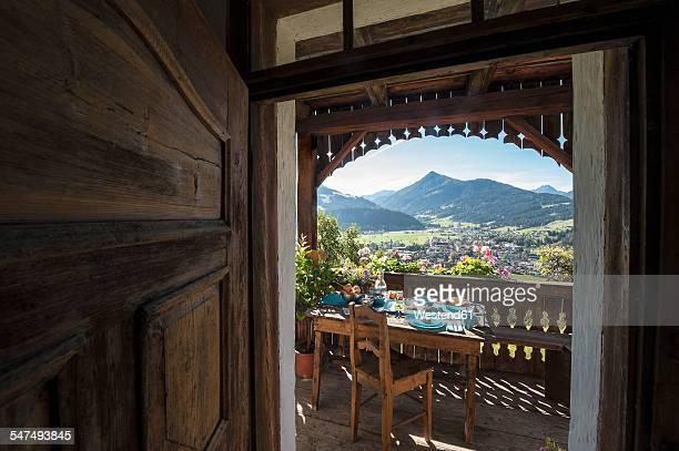 Austria, Salzburg State, Altenmarkt-Zauchense, laid breakfast table on veranda of old farmhouse