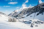 Austria, Salzburg State, Altenmarkt-Zauchensee, chair lift in alpine landscape