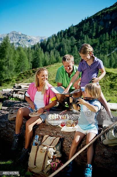 Austria, Salzburg State, Altenmarkt-Zauchensee, family with to children having a picnic