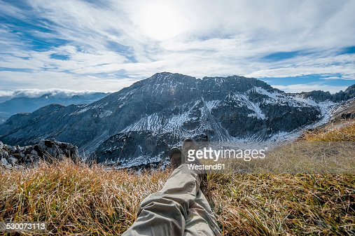 Austria, Salzburg State, Altenmarkt-Zauchensee, man's legs in front of snow-capped cirque