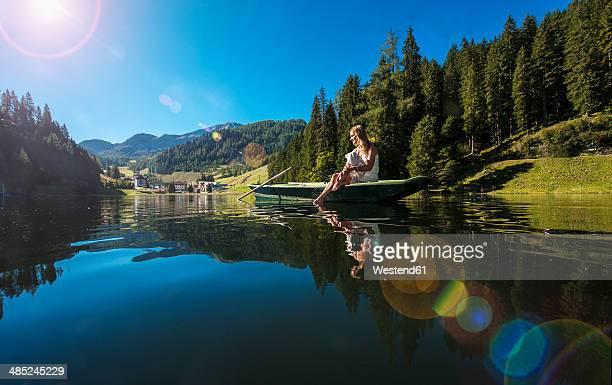 Austria, Salzburg State, Altenmarkt-Zauchensee, woman sitting in a boat