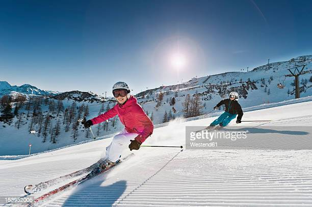 Austria, Salzburg, Young couple skiing on mountain
