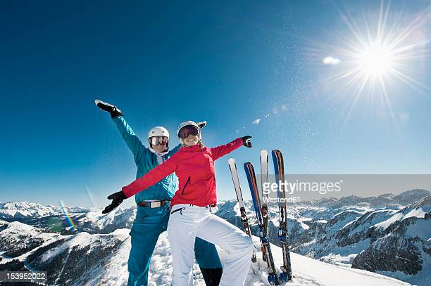 Austria, Salzburg, Young couple standing on top of mountain