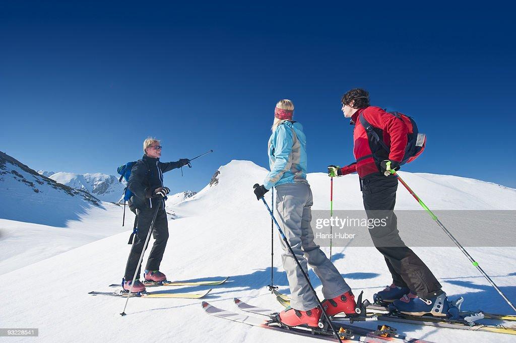 austria salzburger land altenmarkt zauchensee men and woman crosscountry skiing in mountains man. Black Bedroom Furniture Sets. Home Design Ideas