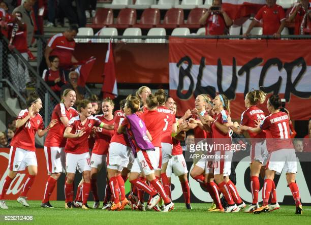 Austria team celebrates in front of supporters as they defeat 30 Iceland during the UEFA Womens Euro 2017 football tournament match between Iceland...