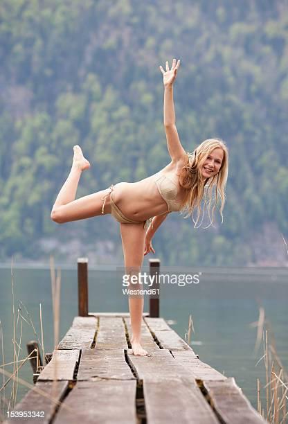 Austria, Teenage girl standing on jetty, portrait