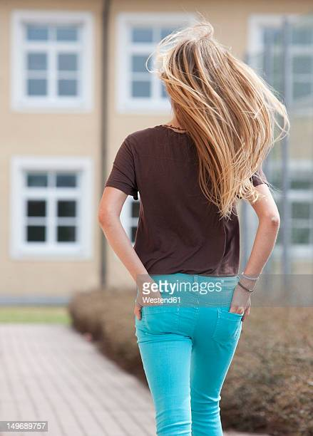 Austria, Teenage girl with hands in pocket