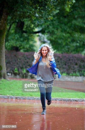 Girl running in rain