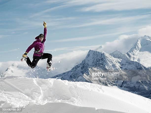 Austria, Tirol, Hintertux Glacier, man jumping for joy, portrait
