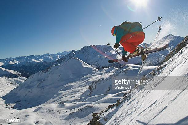 Austria, Tirol, Ischgl, Man ski jumping in snow