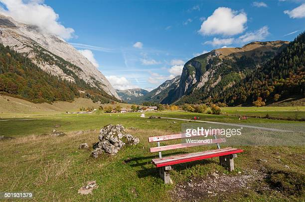 Austria, Tyrol, Alpine Park Karwendel, Wooden bench with the Engalm in the background
