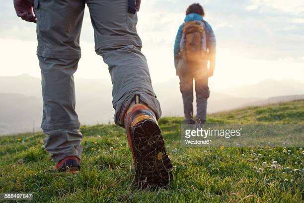 Austria, Tyrol, couple hiking at Unterberghorn at sunrise
