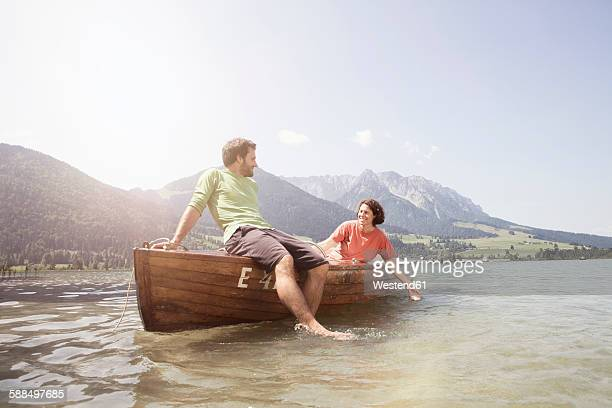 Austria, Tyrol, couple relaxing on a boat on Walchsee