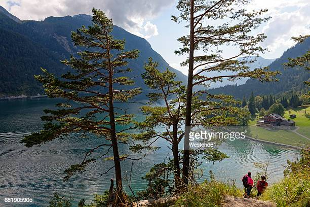 Austria, Tyrol, Hikers at Lake Achensee near Gaisalm
