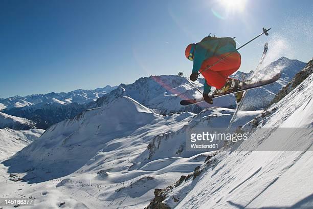 Austria, Tyrol, Ischgl, Mid adult man skiing