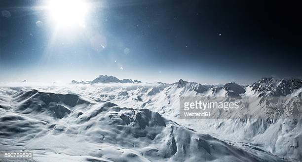 Austria, Tyrol, Ischgl, mountainscape in winter in backlight