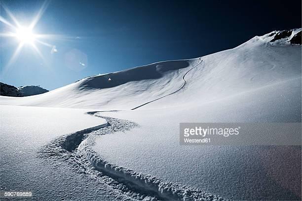 Austria, Tyrol, Ischgl, ski tracks in powder snow