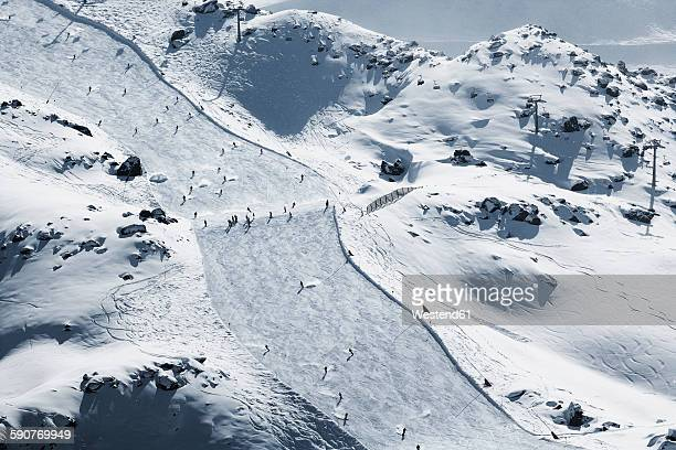 Austria, Tyrol, Ischgl, skiers on slope in winter landscape