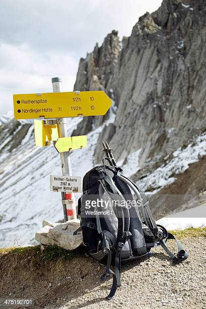 Austria, Tyrol, Karwendel mountains, Rucksack under sign post