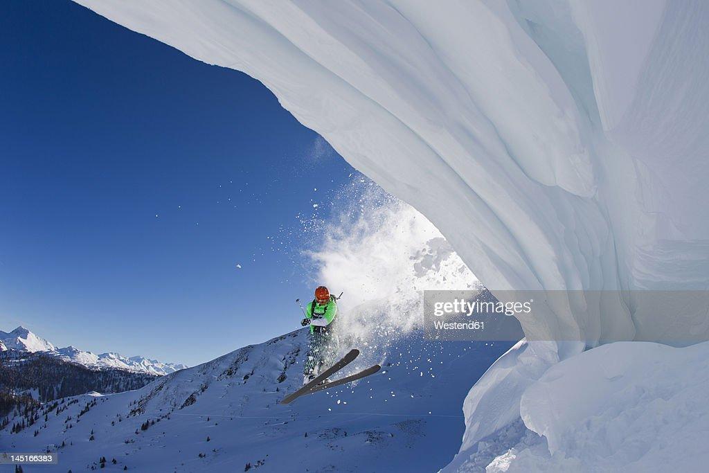 Austria, Tyrol, Kitzbuhel, Mid adult man skiing