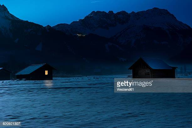 Austria, Tyrol, Lermoos, barn in snow at night