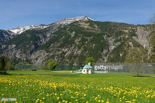 Austria, Tyrol, lighthouse and Seehof chapel at Achensee in alpine landscape