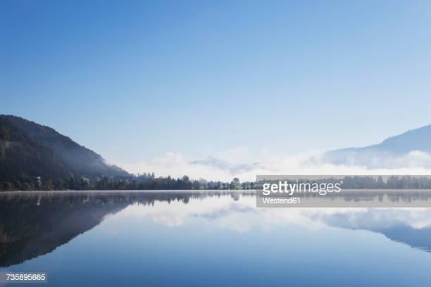 Austria, Tyrol, morning mist at Lake Walchsee