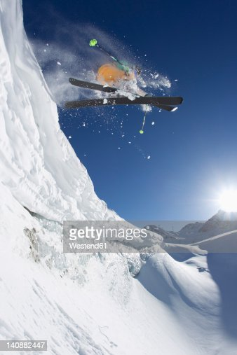 Austria, Tyrol, Pitztal, Mature man doing freestyle skiing : Stock Photo