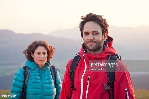 Austria, Tyrol, portrait of couple hiking at Unterberghorn