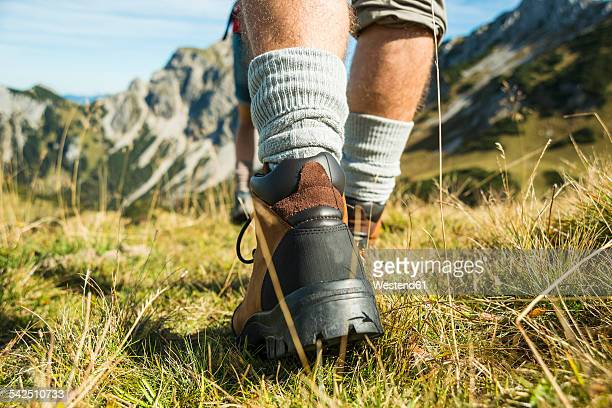 Austria, Tyrol, Tannheimer Tal, close-up of young couple hiking