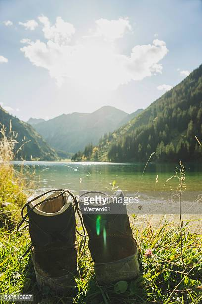 Austria, Tyrol, Tannheimer Tal, hiking boots at mountain lake