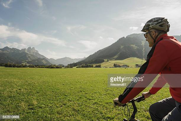 Austria, Tyrol, Tannheimer Tal, man driving mountainbike