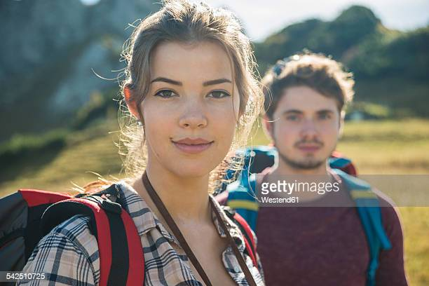 Austria, Tyrol, Tannheimer Tal, portrait of young couple hiking